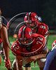Baldwinsville Bees Ben Dwyer (9) behind Center Jack Graham (72) before scoring a touchdown against the Liverpool Warriors in Section III Football action at the Pelcher-Arcaro Stadium in Baldwinsville, New York on Friday, September 22, 2017.  Baldwinsville won 35-7.