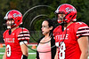 Baldwinsville Bees captains Ben Dwyer (9) and Cameron Majchrzak (78) with special guest walk out for the coin toss with the Liverpool Warriors in Section III Football action at the Pelcher-Arcaro Stadium in Baldwinsville, New York on Friday, September 22, 2017.