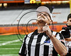 Referee tossing the coin before the Section III Class AA Football Championship game between the Baldwinsville Bees and Cicero-North Syracuse Northstars at the Carrier Dome in Syracuse, New York on Saturday, November 4, 2017.