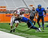 Baldwinsville Bees Ben Dwyer (9) gets tackled by a Cicero-North Syracuse Northstars defender in Section III Class AA Football Championship game action at the Carrier Dome in Syracuse, New York on Saturday, November 4, 2017. Cicero-North Syracuse won 56-21.