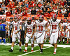 Baldwinsville Bees Captains Ben Dwyer (9), EJ Edmonds (23), Cameron Majchrzak (78) and Gabe Horan (88) walk out for the coing flip before playing the Cicero-North Syracuse Northstars in the Section III Class AA Football Championship game at the Carrier Dome in Syracuse, New York on Saturday, November 4, 2017.