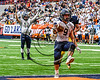 Skaneateles Lakers running back Areh Boni (9) scores one of his two touchdowns as Pat Hackler (10) signals it against the General Brown Lions in Section III Class C Football Championship game action at the Carrier Dome in Syracuse, New York on Saturday, November 4, 2017. Skaneateles won 66-27.