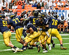 General Brown Lions quarterback Thomas Dupee (12) hands off the ball to Dominic Lutz (21) against the Skaneateles Lakers in Section III Class C Football Championship game action at the Carrier Dome in Syracuse, New York on Saturday, November 4, 2017. Skaneateles won 66-27.