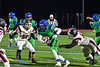 Cicero-North Syracuse Northstars Jaiquawn McGriff (6) running between Elimira Express defenders Thompson Miller (58) and Jeremiah Cheatham (66) in NYS Regional Finals Class AA Football game action at the Micheal Bragman Stadium in Cicero, New York on Saturday, November 10, 2018. Cicero-North Syracuse won 42-20.