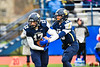 Skaneateles Lakers Quarterback Patrick Hackler (10) hands the ball off to Nick Wamp (17) against the Chenango Forks Blue Devils in NYS Regional Finals Class B Football game action at the Micheal Bragman Stadium in Cicero, New York on Saturday, November 10, 2018. Skaneateles Lakers won 27-26.