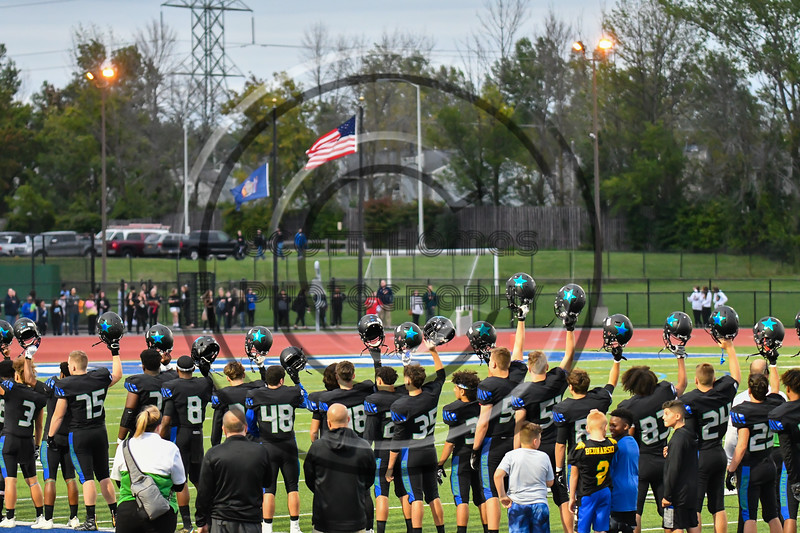 Cicero-North Syracuse Northstars players raise their helmets during the National Anthem before a Section III football game against the Liverpool Warriors at the Micheal Bragman Stadium in Cicero, New York on Friday, September 13, 2019.