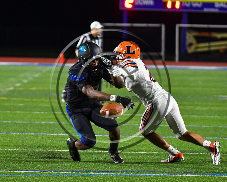 Liverpool Warriors Brayden McClain (2) breaks up a pass against the Cicero-North Syracuse Northstars in Section III football game action at the Micheal Bragman Stadium in Cicero, New York on Friday, September 13, 2019. Liverpool won 10-0.