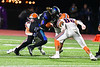 Liverpool Warriors defenders Bryce Mills (30) and Danante Bell (88) team up to tackle Cicero-North Syracuse Northstars Quamir Jenkins (10) running with the ball in Section III football game action at the Micheal Bragman Stadium in Cicero, New York on Friday, September 13, 2019. Liverpool won 10-0.
