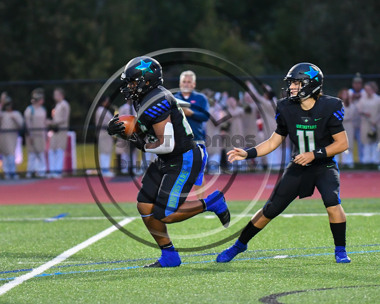 Cicero-North Syracuse Northstars Quarterback JJ Razmovski (11) handed the ball off to Runningback Da-Ron Brown(26) against the Liverpool Warriors in Section III football game action at the Micheal Bragman Stadium in Cicero, New York on Friday, September 13, 2019. Liverpool won 10-0.