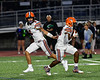 Liverpool Warriors Quarterback Brendan Mancuso (6) handed off the ball to Runningback Dakari Mack (34) against the Cicero-North Syracuse Northstars in Section III football game action at the Micheal Bragman Stadium in Cicero, New York on Friday, September 13, 2019. Liverpool won 10-0.