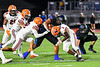 Cicero-North Syracuse Northstars Da-Ron Brown (26) running with the ball gets tackled by Liverpool Warriors defenders Brayden McClain (2) and Malachi Upshur (3) in Section III football game action at the Micheal Bragman Stadium in Cicero, New York on Friday, September 13, 2019.