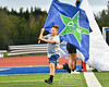 Cicero-North Syracuse Northstars flag bearer runs onto the field before a Section III football game at the Micheal Bragman Stadium in Cicero, New York on Friday, September 13, 2019.