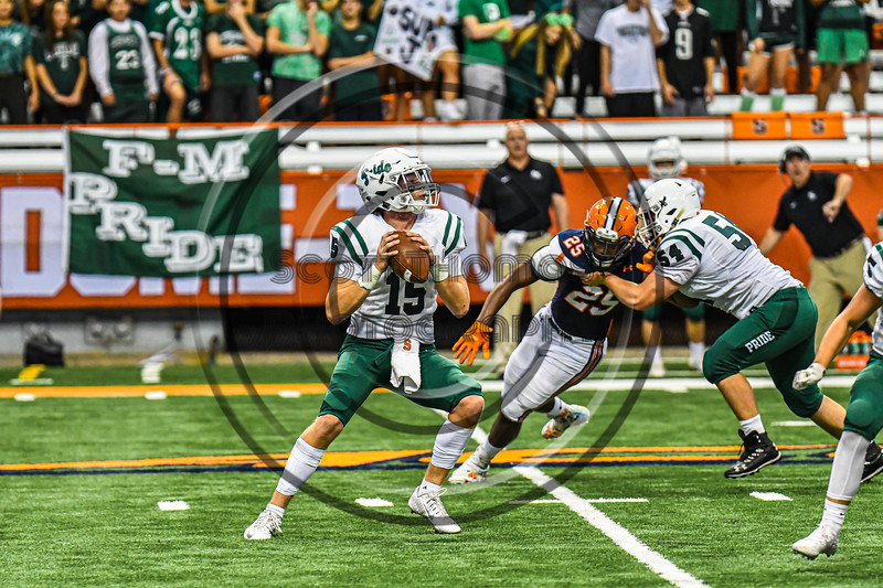 Fayetteville-Manlius Hornets Quarterback Zakary Conley (15) back to pass against the Liverpool Warriors in the 2019 Kickoff Classic at the Carrier Dome in Syracuse, New York. Liverpool won 21-7.