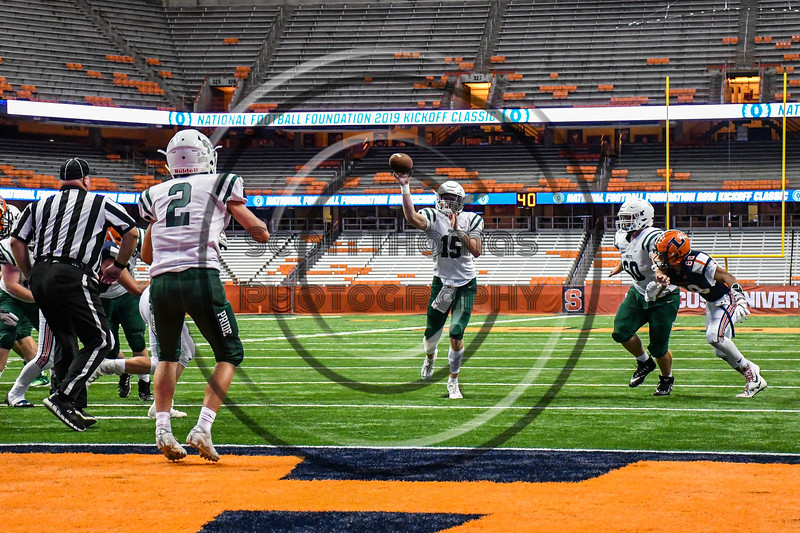 Fayetteville-Manlius Hornets Quarterback Zakary Conley (15) throwing the ball to Jordan Leuze (2) against the Liverpool Warriors in the 2019 Kickoff Classic at the Carrier Dome in Syracuse, New York. Liverpool won 21-7.
