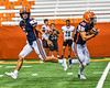 Liverpool Warriors Quarterback Brendan Mancuso (6) after handing off the ball to Running Back Bryce Mills (30) against the Fayetteville-Manlius Hornets in the 2019 Kickoff Classic at the Carrier Dome in Syracuse, New York. Liverpool won 21-7.