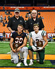 CNY/NFF officals present the Most Valuable Player plaques to Fayetteville-Manlius Hornets Jordan Leuze (2) and Liverpool Warriors Bryce Mills (30) in the 2019 Kickoff Classic at the Carrier Dome in Syracuse, New York. Liverpool won 21-7.