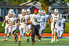 Marcellus Mustangs players and coach warm up before playing the Westhill Warriors in a Section III football game in Syracuse, New York on Friday, September 27, 2019.