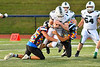 Marcellus Mustangs Quarterback Sean Tierney  (2) gets tackled by Westhill Warriors defenders in Section III football game action in Syracuse, New York on Friday, September 27, 2019. Marcellus won 34-6.