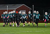 Marcellus Mustangs Head Coach Nick Patterson jogs with his team before playing the Central Valley Academy Thunder in Section III, Class B football game action in Marcellus, New York on Friday, October 25, 2019.