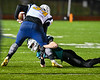Marcellus Mustangs Sean Tierney (2) tackles a Central Valley Academy Thunder runner in Section III, Class B football game action in Marcellus, New York on Friday, October 25, 2019. Marcellus won 17-14.