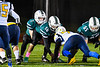 Marcellus Mustangs Quarterback Sean Tierney (2) underneath center Ryan Stoyell (58) against the Central Valley Academy Thunder in Section III, Class B football game action in Marcellus, New York on Friday, October 25, 2019. Marcellus won 17-14.