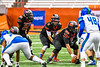 Utica-Proctor Raiders Quarterback Brandon Peterson (4) underneath his Center James Campos (6) against the Cicero-North Syracuse Northstars in Section III Class AA Championship Football game action at the Carrier Dome in Syracuse, New York on Saturday, November 9, 2019. Cicero-North Syracuse Northstars won 28-25.