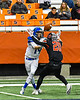 Cicero-North Syracuse Northstars Adron Pafford (14) is stopped from catching the ball by Utica-Proctor Raiders Mike Reali (20) in Section III Class AA Championship Football game action at the Carrier Dome in Syracuse, New York on Saturday, November 9, 2019. Cicero-North Syracuse Northstars won 28-25.