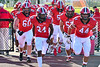 Baldwinsville Bees Samuel Mellinger (24) and Daniel Ewald (44) lead the Bess on to the field to play the West Genesee Wildcats in a Section III Football game at the Pelcher-Arcaro Stadium in Baldwinsville, New York on Friday, September 3, 2021.