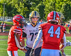 West Genesee Wildcats Captain Christian Becker (73) greets Baldwinsville Bees Captains Samuel Mellinger (24) and Daniel Ewald (44) after the coin toss before a Section III Football game at the Pelcher-Arcaro Stadium in Baldwinsville, New York on Friday, September 3, 2021.