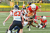 Fulton Red Raiders Quarterback William Patterson (11) gets tackled by East Syracuse-Minoa Spartans Mikah Combs (6) in Section III Football action in Fulton, New York on Friday, September 17, 2021. East Syracuse-Minoa won 53-20.