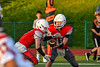 Fulton Red Raiders Quarterback William Patterson (11) hands the ball off to Running Back Anthony Mills (7) against the East Syracuse-Minoa Spartans in Section III Football action in Fulton, New York on Friday, September 17, 2021. East Syracuse-Minoa won 53-20.