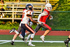 East Syracuse-Minoa Spartans Mikah Combs (6) chases after Fulton Red Raiders Tyler Mills (10) in Section III Football action in Fulton, New York on Friday, September 17, 2021. East Syracuse-Minoa won 53-20.