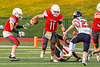 Fulton Red Raiders Quarterback William Patterson (11) gets tackled by East Syracuse-Minoa Spartans Gideon Ezomo (65) in Section III Football action in Fulton, New York on Friday, September 17, 2021. East Syracuse-Minoa won 53-20.