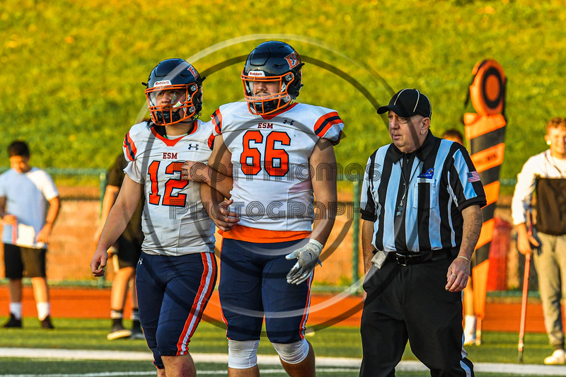 East Syracuse-Minoa Spartans Captains Tyler Bell (12) and Conor Todd (66) walk out for the coin flip against the Fulton Red Raiders before a Section III Football game in Fulton, New York on Friday, September 17, 2021.