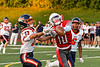 East Syracuse-Minoa Spartans Damon Jones (13) breaks up a pass to Fulton Red Raiders Tyler Mills (10) in Section III Football action in Fulton, New York on Fridday, September 17, 2021. East Syracuse-Minoa won 53-20.
