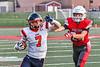East Syracuse-Minoa Spartans Jackson Palumb (7) avoids Fulton Red Raiders Alexander Crisafulli (24) to score a touchdown in Section III Football action in Fulton, New York on Friday, September 17, 2021. East Syracuse-Minoa won 53-20.