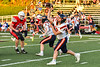 East Syracuse-Minoa Spartans Quarterback Tyler Bell (12) passing the ball against the Fulton Red Raiders in Section III Football action in Fulton, New York on Friday, September 17, 2021. East Syracuse-Minoa won 53-20.