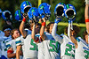 Cicero-North Syracuse Northstars players raise their helmets during the National Anthem before a Section III Football game against the Baldwinsville Bees at the Pelcher-Arcaro Stadium in Baldwinsville, New York on Friday, September 24, 2021.