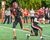 Baldwinsville Bees Quarterback Caden Cox (2) hands off the ball to Running Back Amir Akins (22) against the Cicero-North Syracuse Northstars in Section III Football action at the Pelcher-Arcaro Stadium in Baldwinsville, New York on Friday, September 24, 2021. Cicero-North Syracuse won 40-7.