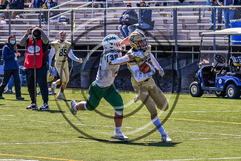Fayetteville-Manlius Hornets Jack Nucerino (32) catches West Genesee Wildcats Benjamin Chamberlain (17) in Section III Football action at Mike Messere Field in Camillus, New York on Saturday, April 3, 2021. West Genesee won in OT 38-32.