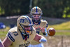 West Genesee Wildcats Quarterback Braeden McNeill (18) about the received the football from a shotgun hike in Section III Football action at Mike Messere Field in Camillus, New York on Saturday, April 3, 2021. West Genesee won in OT 38-32.