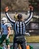 Referee signalling a touchdown by West Genesee Wildcats against the Fayetteville-Manlius Hornets in Section III Football action at Mike Messere Field in Camillus, New York on Saturday, April 3, 2021. West Genesee won in OT 38-32.