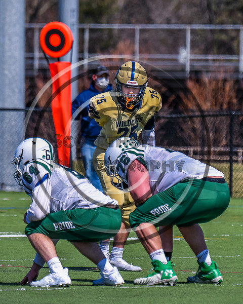 West Genesee Wildcats Scott Fura Jr (75) before the ball is snapped against the Fayetteville-Manlius Hornets in Section III Football action at Mike Messere Field in Camillus, New York on Saturday, April 3, 2021. West Genesee won in OT 38-32.