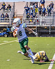 Fayetteville-Manlius Hornets Thomas Conley (2) avoids a tackle by West Genesee Wildcats Joseph Maione (10) on the opening kickoff in Section III Football action at Mike Messere Field in Camillus, New York on Saturday, April 3, 2021. West Genesee won in OT 38-32.