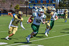 Fayetteville-Manlius Hornets Jack Nucerino (32) runs past West Genesee Wildcats defenders Dominick Burris (2) and River Oudemool (11) for a touchdown in Section III Football action at Mike Messere Field in Camillus, New York on Saturday, April 3, 2021. West Genesee won in OT 38-32.