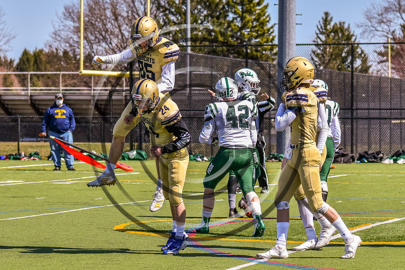 West Genesee Wildcats Colin McAvan (85) congratulates Nathaniel Burkett (24) for blocking the Extra Point against the Fayetteville-Manlius Hornets in Section III Football action at Mike Messere Field in Camillus, New York on Saturday, April 3, 2021. West Genesee won in OT 38-32.