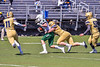 Fayetteville-Manlius Hornets Thomas Conley (2) gets tackled by West Genesee Wildcats Daniel Becker Jr (52) in Section III Football action at Mike Messere Field in Camillus, New York on Saturday, April 3, 2021. West Genesee won in OT 38-32.
