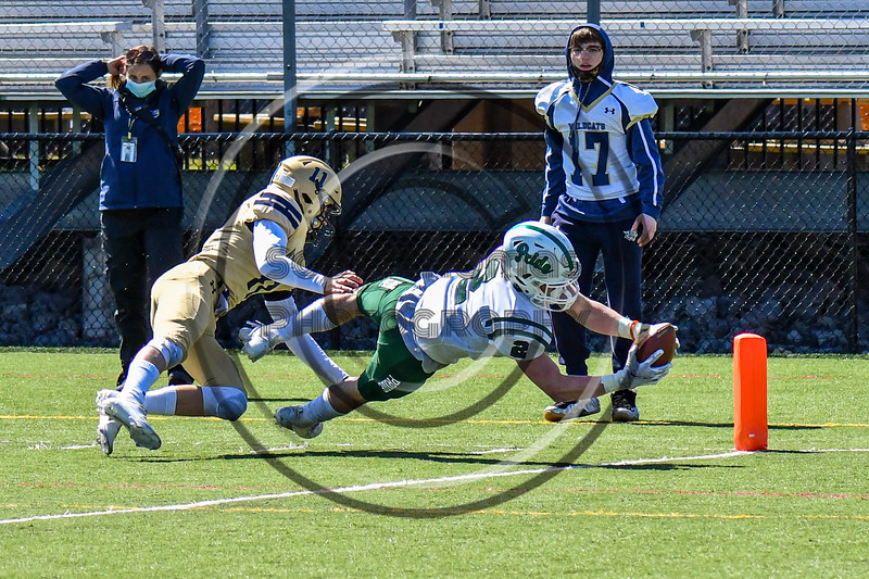 Fayetteville-Manlius Hornets Thomas Conley (2) reaches for the End Zone to score a touchdown against the West Genesee Wildcats in Section III Football action at Mike Messere Field in Camillus, New York on Saturday, April 3, 2021. West Genesee won in OT 38-32.