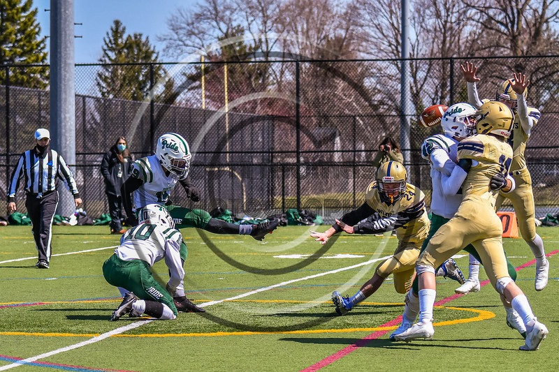 Fayetteville-Manlius Hornets Joshua Bertrand (19) Extra Point attempt is blocked by West Genesee Wildcats Nathaniel Burkett (24) in Section III Football action at Mike Messere Field in Camillus, New York on Saturday, April 3, 2021. West Genesee won in OT 38-32.