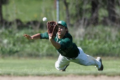 Maloney's Tanner Raymond dives for a fly ball Tuesday at Maloney High School in Meriden May 8, 2018 | Justin Weekes / Special to the Record-Journal